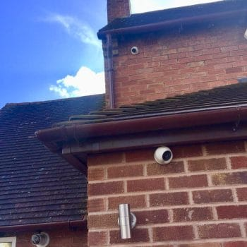 two CCTV cameras on house