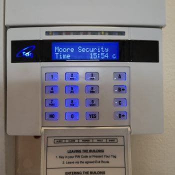 Alarm panel lit up on wall