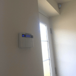 Pyronix keypad and PIR mounted on wall