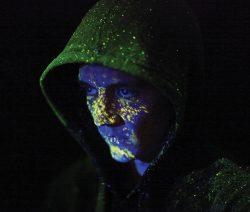 SmartWater UV spray on face